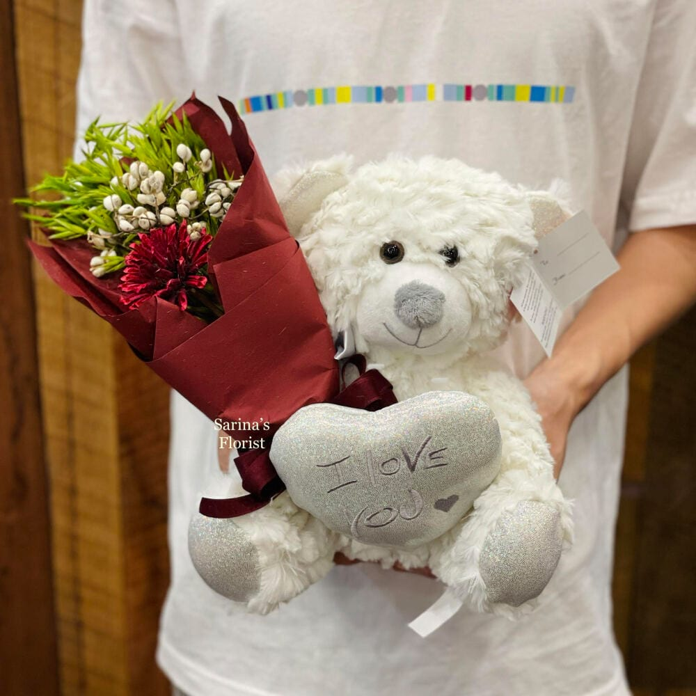 Brown teddy bear with preserved blue rose posy