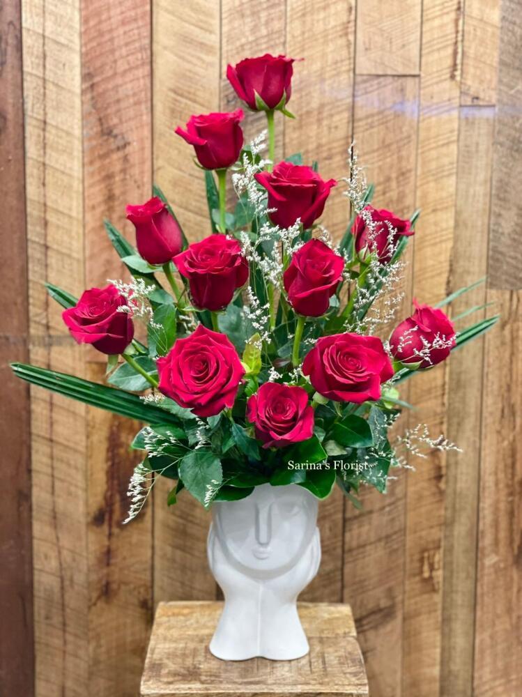 12 stems of premium red roses in a deisgner`s pot