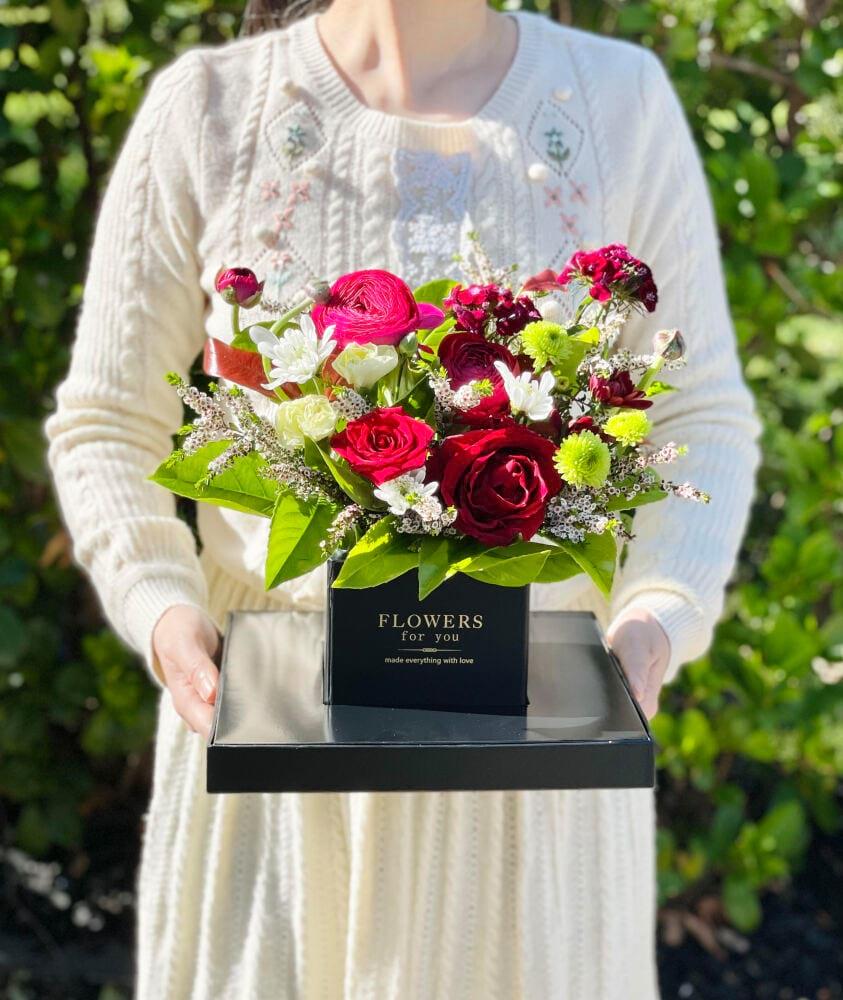 Seasonal greeting gift box in burgundy colors