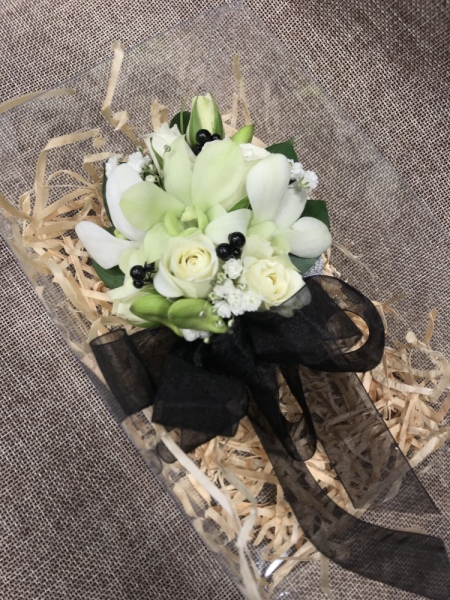 Wrist Corsage White & Black in a presentation